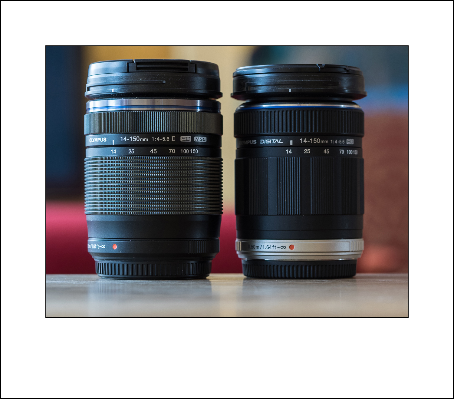 The two Olympus 14-150 lenses